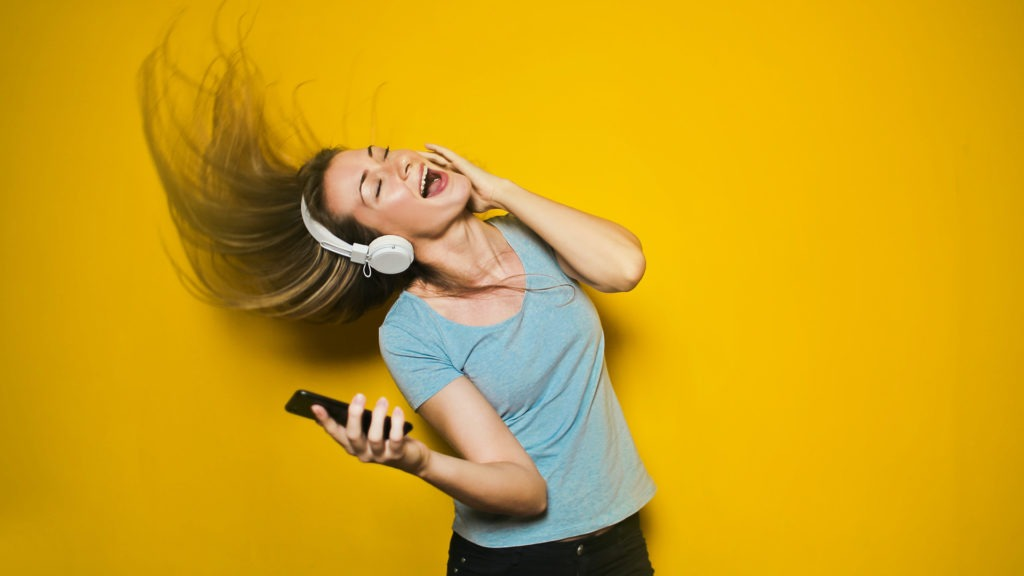 Woman dancing to quickly improve mood