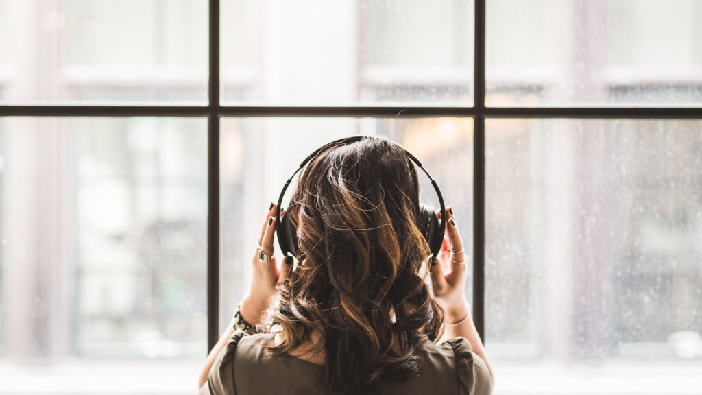 Woman listening to music to quickly improve her mood