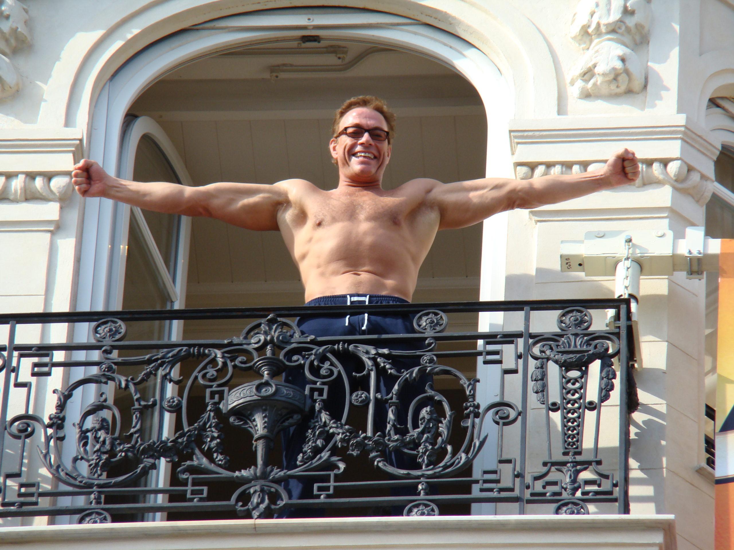 Van Damme showing his upper body muscles