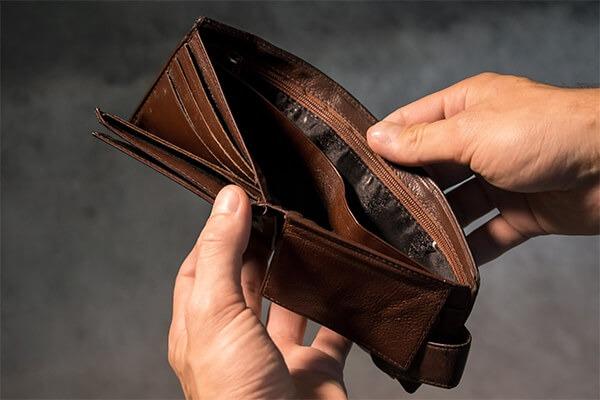 Empty wallet proving poor money-saving habits