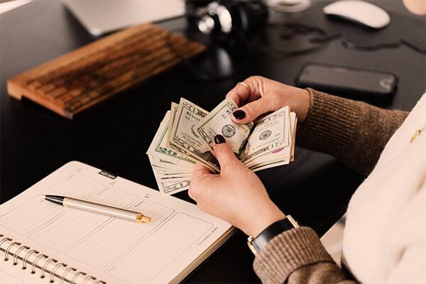 Woman counting dollars like a good money saver.