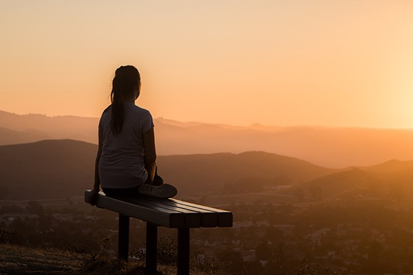 Woman meditating at how to find her passion.