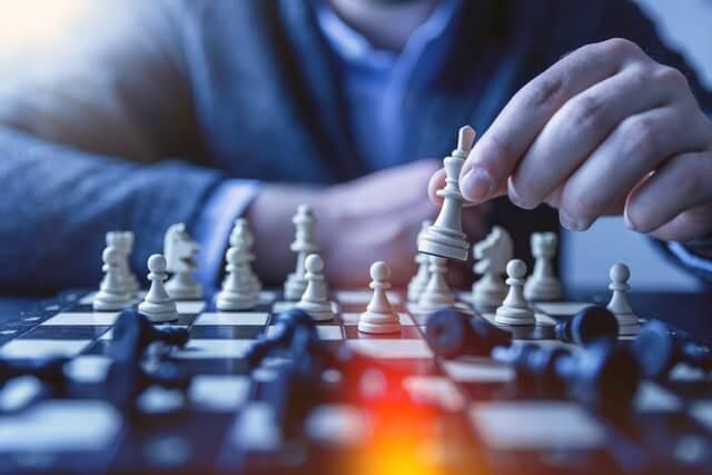 Man playing chess, a brain training board game.