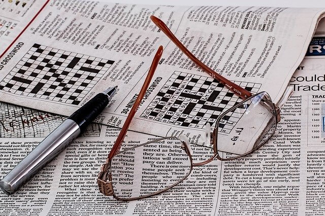 Crosswords, one of the cognitive games for adults, and newspapers