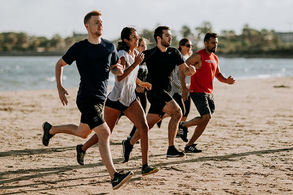 A group of men and women following their smart fitness goals to increase endurance