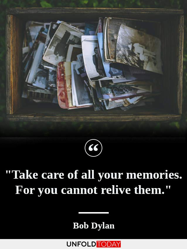 A drawer full of old pictures and a quote by Bob Dylan saying